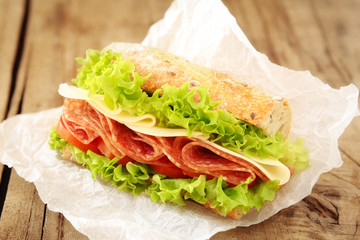Fresh sandwich with salami, cheese, tomatoes and lettuce