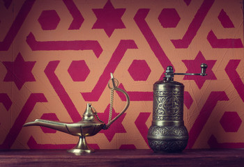 Muslim still life. Lamp and mill