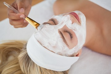 Beautiful blonde getting a facial treatment