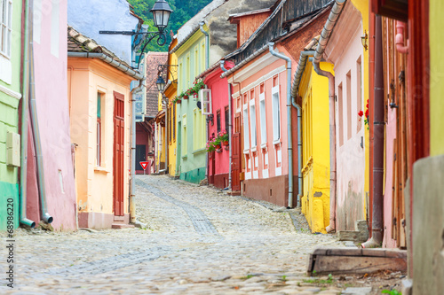 Medieval street view in Sighisoara founded by saxon colonists in - 68986220