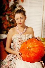 Young woman in vintage dress on autumn porch. Beauty  girl in fa