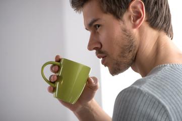 closeup portrait of thoughtful man having coffee.