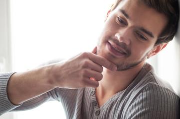 closeup portrait of attractive young man.