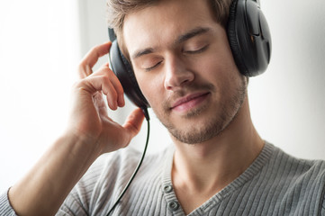 Handsome young man listening to music.