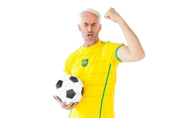 Cheering brazilian football fan in yellow