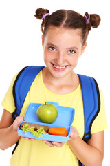Schoolgirl with healthy lunchbox