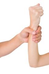 Mans hand grabbing womans wrist