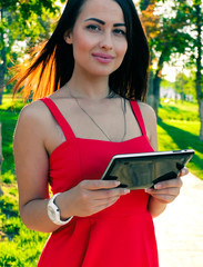 Female student with tablet-pc in use