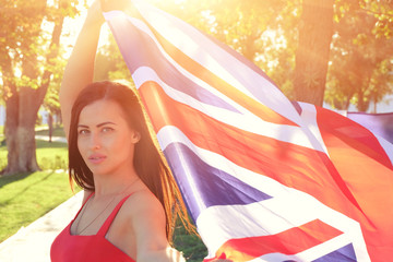 British girl holding the Jack Union flag in her hands