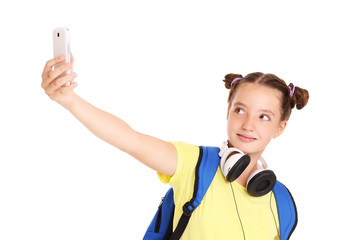Schoolgirl taking pictures with her smartphone