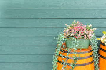 old wooden barrel with beautiful flowers