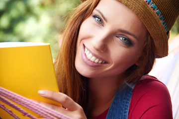 beautiful young woman relaxing and reading a book