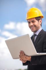 handsome architect man holding laptop.