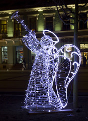 Christmas street decorations - angel playing the trumpet made of