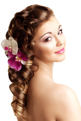 Makeup and hairstyle. Young beautiful woman with luxurious hair.
