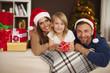 Portrait of loving family in christmas morning