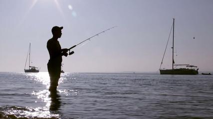 Fisherman silhouette at Ria Formosa, Algarve.