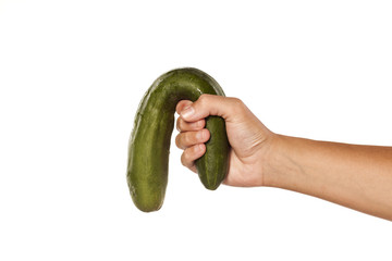 female hand holding a distorted cucumber on white background