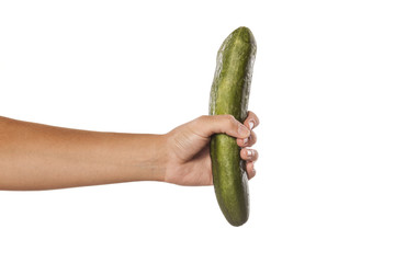 female hand holding a cucumber on white background