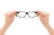 Leinwandbild Motiv Male hands holding a pair of glasses
