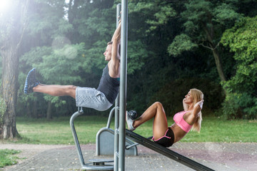 Couple working out on outdoor gym