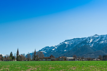 Beautiful scene of town with green field and trees at Interlaken