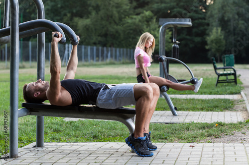 canvas print picture People training on the outdoor gym