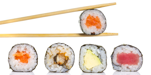 Little sushi maki roll with chopsticks isolated
