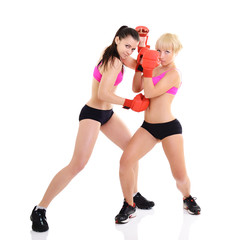 sport training of two boxing young woman, studio over white