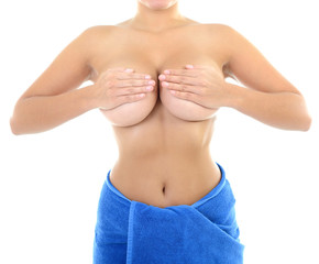 Body of beautiful woman covering her breast with hand in blue to