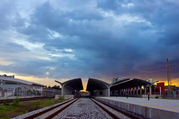 Landscape of railway station on sunset
