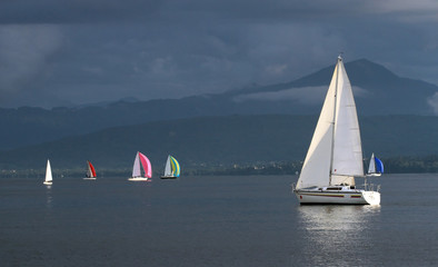 Sailing boats by stormy weather, Geneva lake, Switzerland