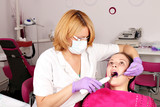 girl patient and dentist in dental office - 68995067