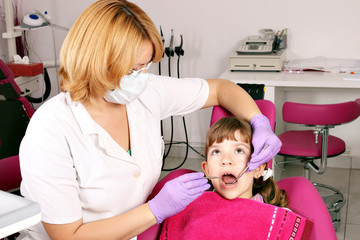 child patient and female dentist