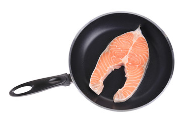 Salmon steak on frying pan.