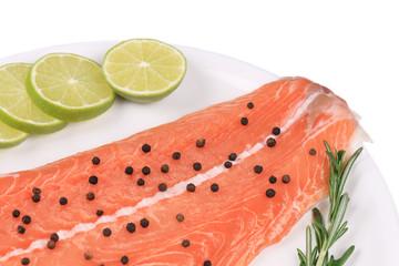 Raw salmon steak with rosemary.