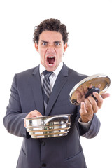 dissatisfied man holding pot for cooking with expression