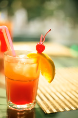 cocktail decorated with cherry