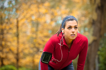 Female athlete taking a running work out rest