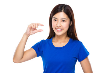 Woman with finger show small distance