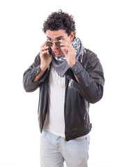 good looking man in a leather jacket talking over phone