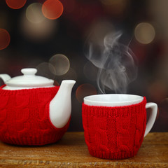 Teapot and cup in front of sparkle lights background