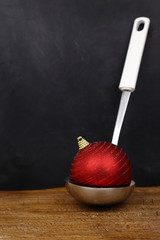Christmas ball in a serving spoon and copy space