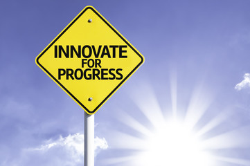 Innovate for Progress road sign with sun background