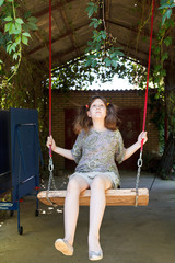 girl on swing in yard