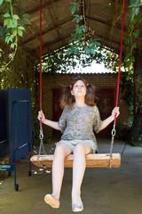 girl on swing in yard