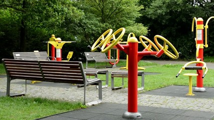 senior park (exercise machines) with benches - in the park