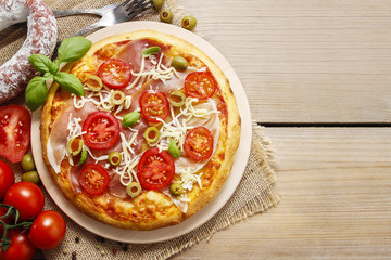 Italian cuisine: pizza with salami