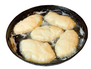 patties frying in pan isolated on white