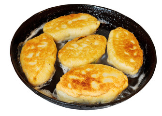patties with spring onion and eggs in frying pan